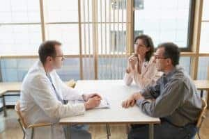 Picture Of Physician Dispensed With Couple Discussion