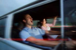 Man And Woman Statistical Madness Traveling Fast In Car