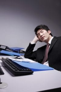 Man Sleeping Waste Time On Workers Comp On Office Table