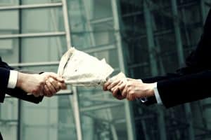 Picture Two People Fighting Over Newspaper IRS Advice on Subcontractor vs. Employee