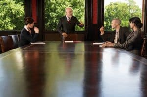 Picture Businesspeople Meeting Around Boardroom Table Businessman Standing IRS Advice Subcontractor vs. Employee