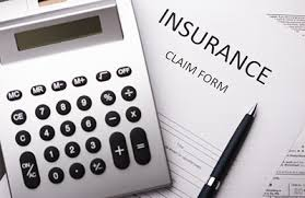 Picture of Insurance Claim Form Workers Comp Self Insured Resolutions With Calculator and Pen