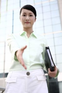 Picture of Woman Extending Hand for Handshake Accountable Care Organizations (ACO's)