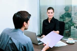 Businessman Networks Cost Passing Document To Businesswoman