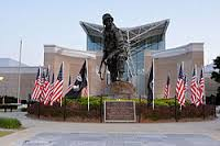 Picture of North Carolina's Largest Still Free Safety Conference Building with Statue and Flags
