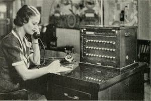 Old picture of woman fee schedules using old telephone