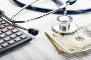 Picture Of Dollars Stethoscope SB 863 And Calculator
