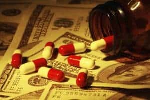 Picture Of Pill Capsules Workers Comp Fee Schedules On US Paper Currency