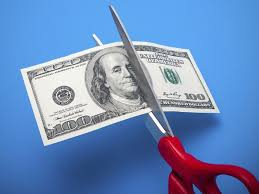 Graphic of Cutting Workers Comp Costs scissor cutting dollar