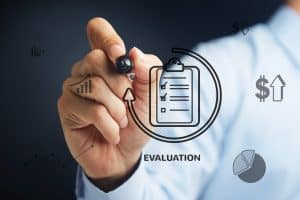 Hand Illustrating IRS Independent Contractor Evaluation