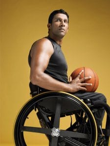 Man Sitting Wheel Chair Workers' Compensation Ended Holding Ball