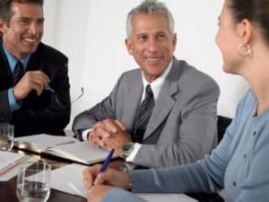 Picture of Premium Audit Workpapers Three Business Colleagues in Conference Meeting