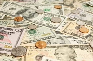 Dollars and Coins Save on Workers Comp Premiums Cash