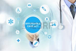 Picture of Doctor Hand Touching Affordable Care Act Sign on Virtual Screen