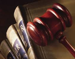 Picture of Captive RRG Legal books of Law with Gavel