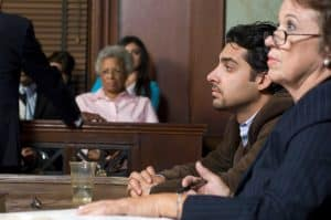 Defense Lawyer System Still Works With Client In Court
