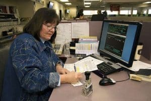 Woman Working Loss Cost Multipliers On Computer