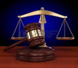 Picture of Nevada Workers Comp Gets Trashed Gavel and Weighing Scale