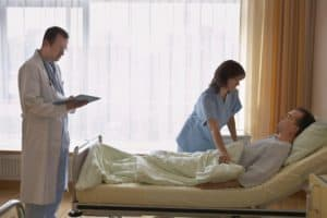Doctor And Nurse North Carolina Medical Treatment Of Patient At Hospital Bed