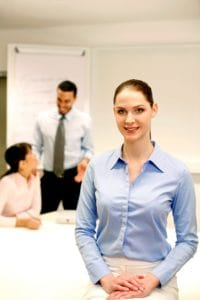 Woman Work Comp safety With Colleagues