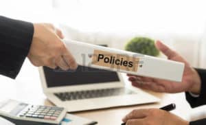 Picture Of Hand Giving Policies Files Best Workers Comp Policy On Other Hand