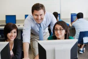 Picture Of Human Resources Training Of Employee On Computer
