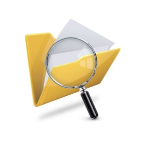 Picture Of Folder and Magnifying Glass Workers Comp Classification Codes Concept