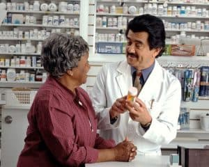 Woman Consult WCIRB Long Tail Medical Expenses With Pharmacist