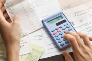 Woman Hand Doing NCCI Calculate Expenses