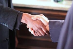Picture Of Hand Shaking Trans-Pacific Partnership Agreement