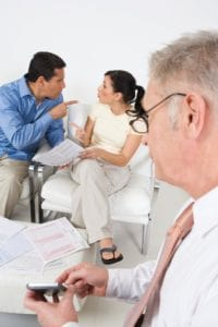 Picture of Businessman Assisting Angry Couple Workers' Compensation Issues Webinar