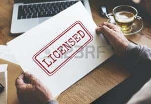 Picture Hand Licensed Workers Comp Premium Auditors Approval