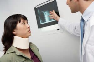 Doctor And Woman Patient Worker Outcomes Examining X-Ray