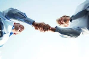 Two Man Shaking Hands Oklahoma Opt-Out Insurance Deal