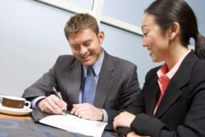 Man Associate In Claims Signing