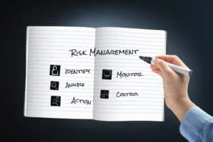 Hand Illustrating Associate in Risk Management With Pen