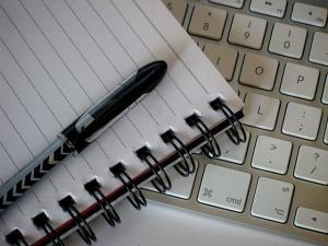 Pen Self Insured Resolutions on top of paper