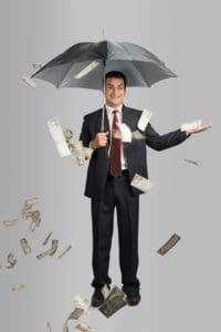 Businessman North Carolina Workers Comp Uninsureds Using Umbrella With Money