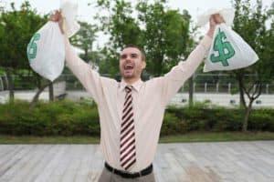 Businessman Safety Incentive Plans Holding Sacks Of Money