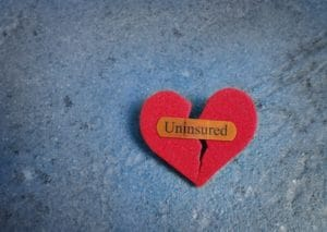 Picture of Broken Red Heart bandaid of Uninsured text north carolina workers comp uninsureds