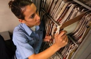 Woman North Carolina Rate Bureau Getting Files In Record Cabinet