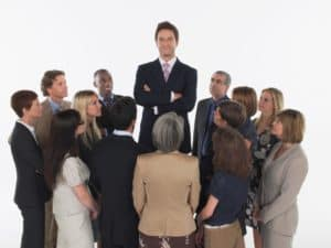 Business People US Workers Comp System Staring At Leader