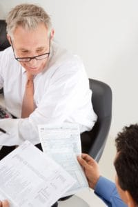 Businessmen Work Comp Tax Question Working In Office