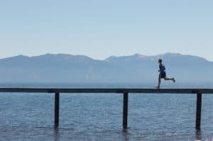Man Running Older Workers At Bridge Mountain And Ocean View Behind