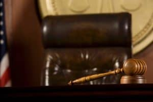 Gavel Lying IRS Contractor Employee Rules In A Court Room