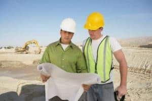 Picture Of Two Man Employer and Employee Independent Contractor Employee Checklist On Construction Area
