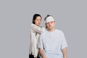 Female Doctor Kentucky HB 1 Dressing Patient Head With Bandage