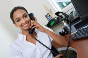 Lady Using Telephone 401k 403b limit At Office