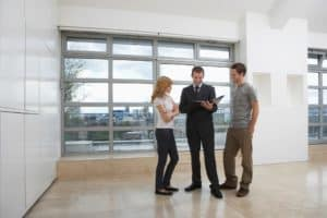 Couple With Agent 2018 Workers Comp Resolutions In Apartment