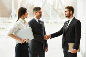 Businessmen shaking hands New IRS Subcontractor Rules